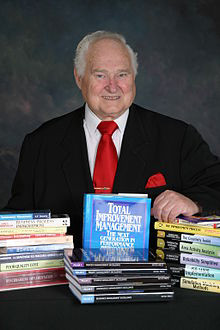 Dr  H James Harrington with Books